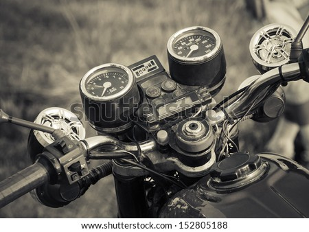 Vintage motorbike. Devices on a steering bracket on the old bike. - stock photo