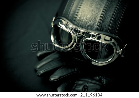 Vintage motorcycle helmet with gloves and goggles - stock photo