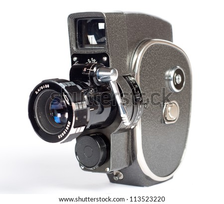 Vintage movie camera isolated on white - stock photo