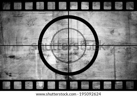 Vintage movie film strip with countdown border over grunge background - stock photo