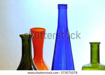 Vintage multicolor bottles close up. - stock photo