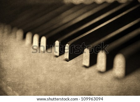 Vintage musical background, piano keyboard - stock photo