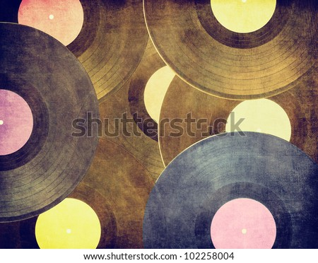 Vintage musical background, vinyl record on scratched surface - stock photo