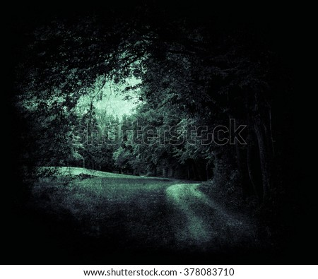 Vintage  mystical photo of calm countryside with rural sandy road. Agricultural landscape with old fashioned colors. Beautiful nature landscape - stock photo