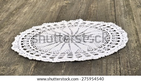 Vintage napkin, tied with white thread, on a wooden table - stock photo