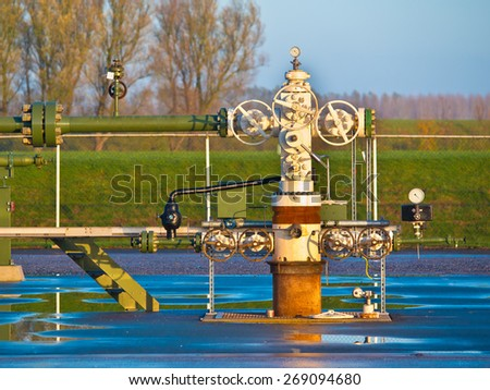 Vintage natural gas well head in the early morning in Grijpskerk, Netherlands - stock photo