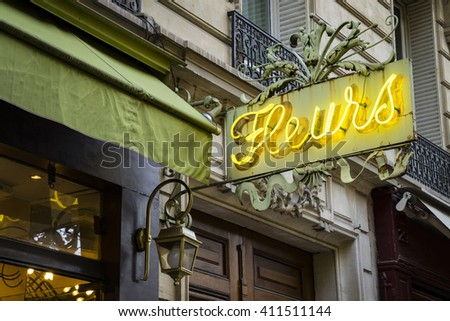 Vintage neon sign for flower shop in Paris, displaying Fleurs - stock photo