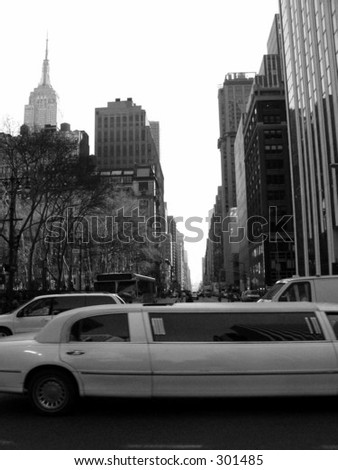 Vintage New York City limo scene. A stretch limo rushes through the streets of New York City.