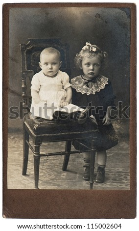 vintage nostalgic portrait of two girls ca. 1910 - stock photo