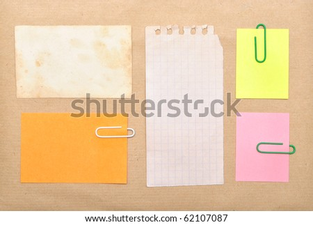 vintage notes over brown cardboard background