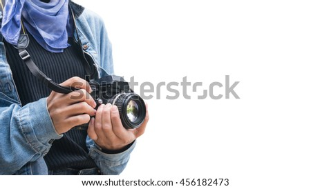 Vintage of beautiful women photography standing hand holding retro camera. This has clipping path.