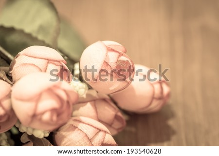 vintage of bouquet of pink roses on wood background - stock photo