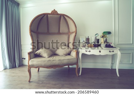 Vintage of brown sofa and untidy desk - stock photo