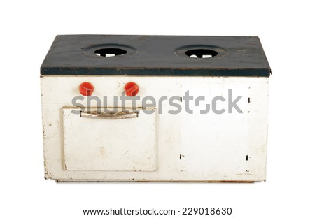 Vintage off white doll house cooking stove - stock photo