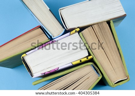 Vintage old books on  light background. Books and reading are essential for self improvement, gaining knowledge and success in our careers, business and personal lives.