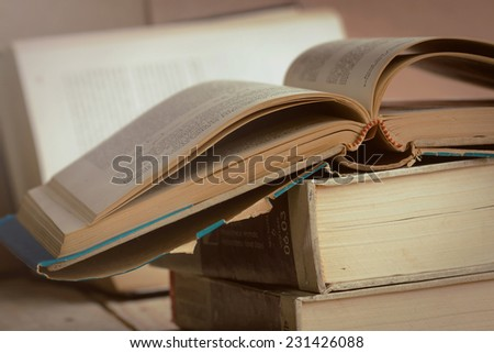 Vintage old books on wooden background - stock photo