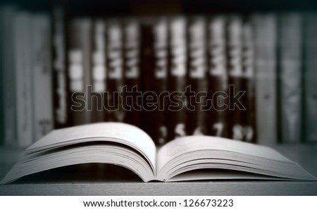 Vintage old books on wooden deck. Image with selective focus