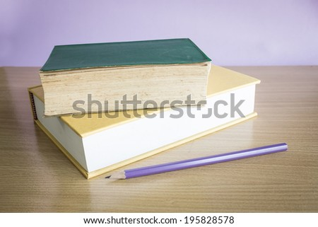 vintage old books stacked on table - stock photo