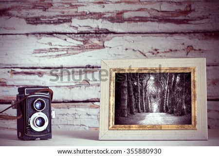Vintage old camera and photo frame - stock photo