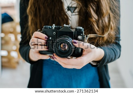 vintage old camera in hand - stock photo