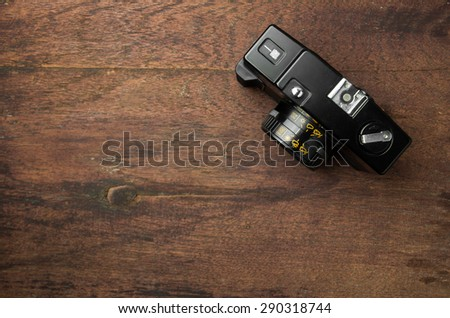 Vintage old camera on wooden background. - stock photo