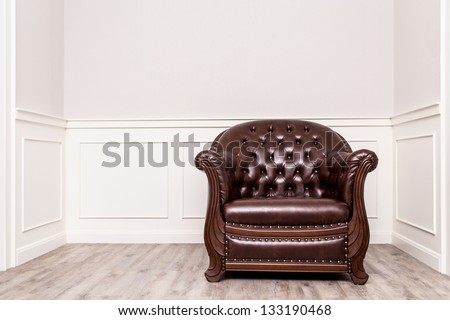 Vintage old chair, sofa in the corner of vintage room - stock photo