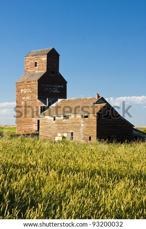 Vintage old-fashioned buildings abandoned in an old ghost town - stock photo