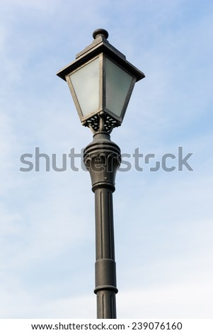 Vintage Old Fashioned Street Light in blue sky. - stock photo