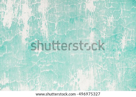Vintage old grunge aquamarine painted street wall texture background. Retro style filtered photo