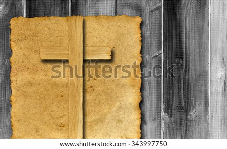 Vintage old grungy paper banner with a Christian religious cross over ancient wood background for religion or faith designs - stock photo
