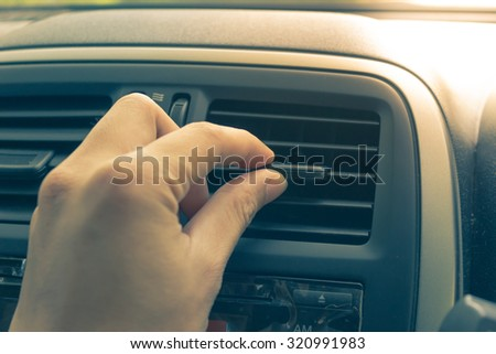 Vintage old image of man hand turn signal switch. Car interior detail.