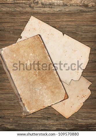 Vintage old papers on a wooden background