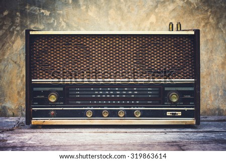 Vintage old radio receiver device in wooden dark room.