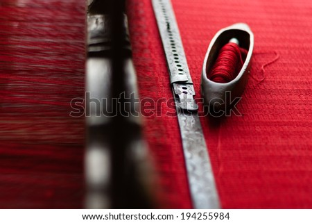 vintage old retro loom with red strings - stock photo