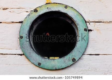 Vintage, old round porthole window - stock photo