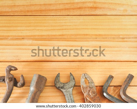 Vintage old rust tool, screwdriver, wrench, drill, hex key, construction tools on wooden background with copy space at top. Working tools background. Father's day concept. - stock photo