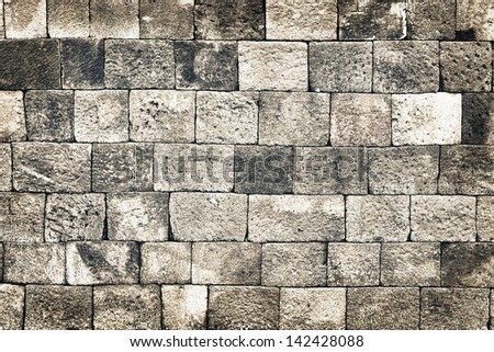 Vintage old style aged stone wall grunge pattern - stock photo