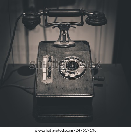vintage old telephone black and white photo