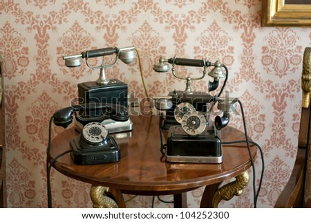vintage old telephones retro background - stock photo