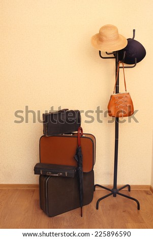 Vintage old travel suitcases on floor in vestibule - stock photo