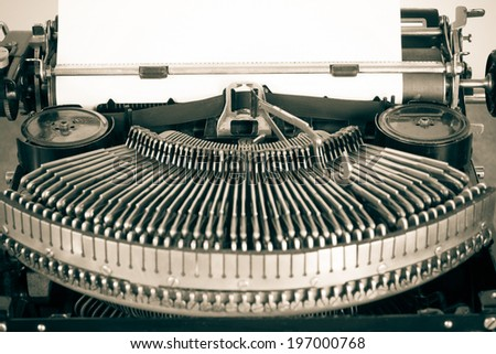 Vintage old typewriter and paper blank closeup sepia photo - stock photo