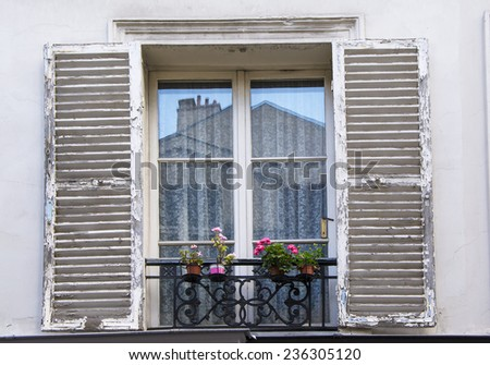 Vintage old window with open wooden shutters and flowers - stock photo