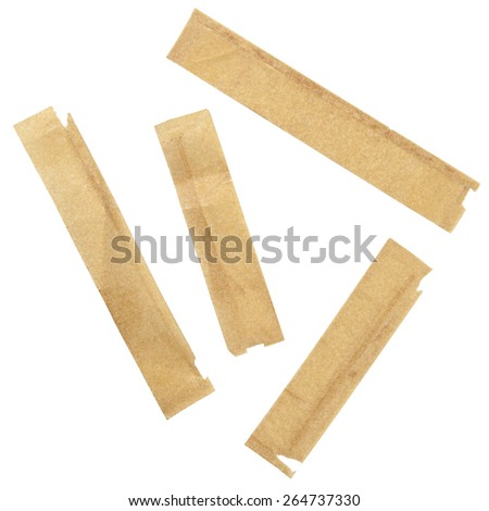 Vintage old yellowed tape pieces isolated on white - stock photo