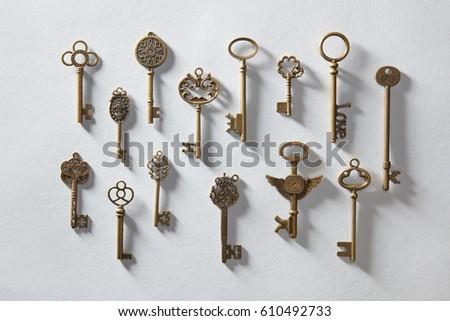 Vintage or antique door keys on white paper - Vintage Antique Door Keys On White Stock Photo (Royalty Free