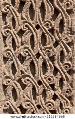 Vintage Ornament from lines and patterns handmade decorating the wall of Medieval Armenian Church - stock photo