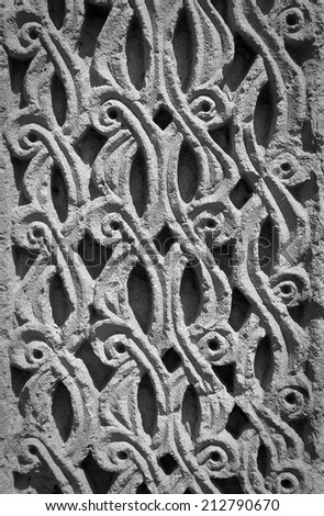 Vintage Ornament from lines and patterns handmade decorating the wall of Medieval Armenian Church  in monochrome - stock photo