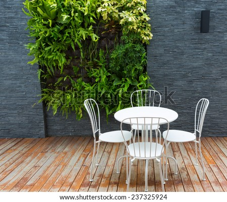 Vintage outdoor coffee table in cafe wooden terrace - stock photo