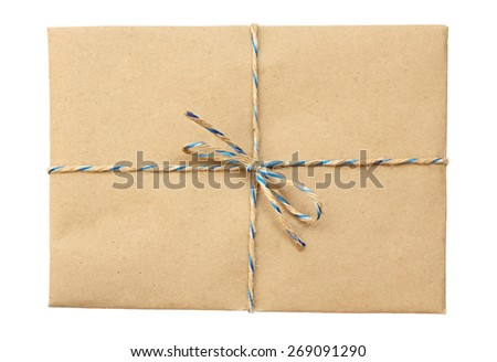 Vintage package  tied up with string isolated on a white background - stock photo