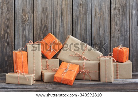 Vintage packages against the background of the old wooden boards - stock photo