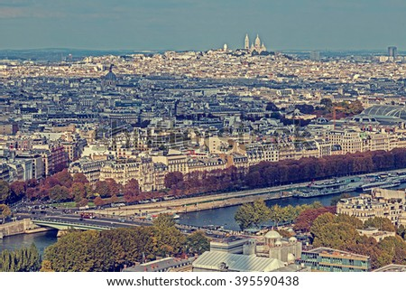 Vintage panorama and aerial view from Eiffel tower in Paris, France, with Basilica Sacre Coeur on background. - stock photo